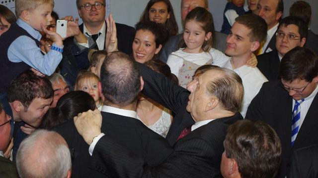 President Monson gives high five to little boy in Hamburg